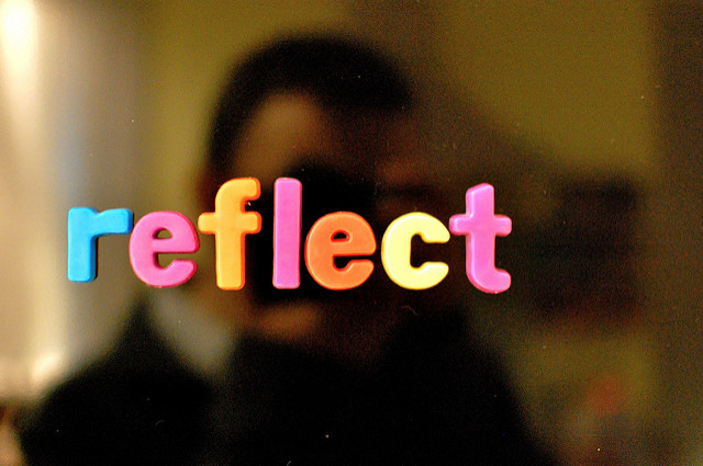 Fridge magnets spelling out the word Reflect