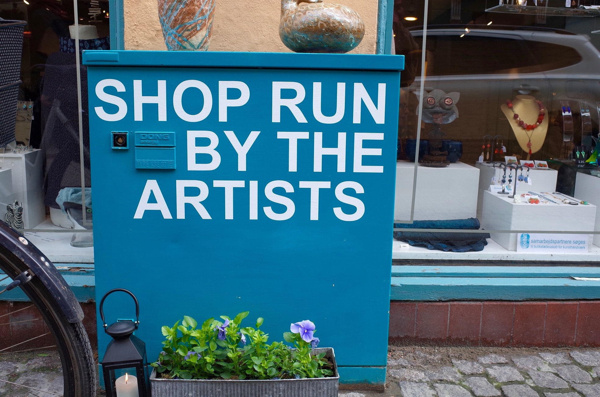 A sign that reads 'shop run by the artists'
