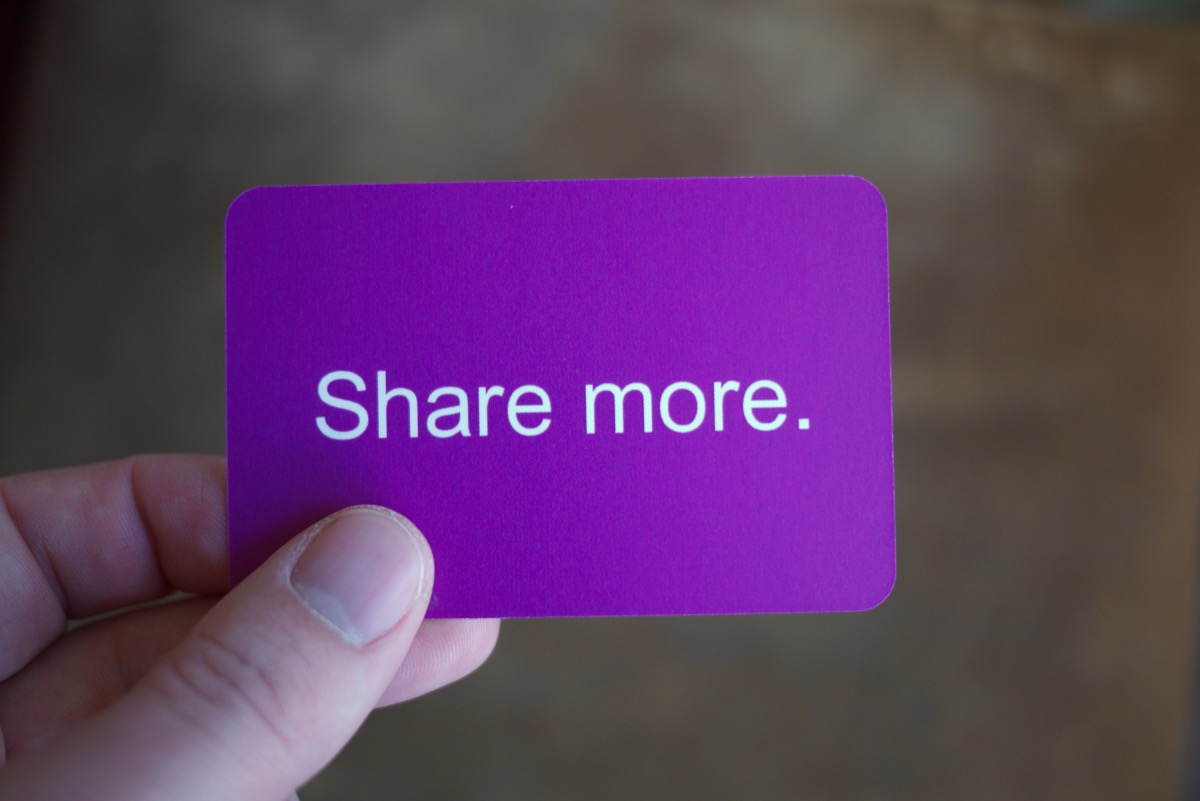 A card that says SHARE MORE