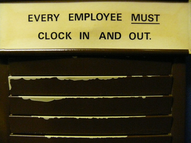 Sign saying Every Employee Must Clock In And Out
