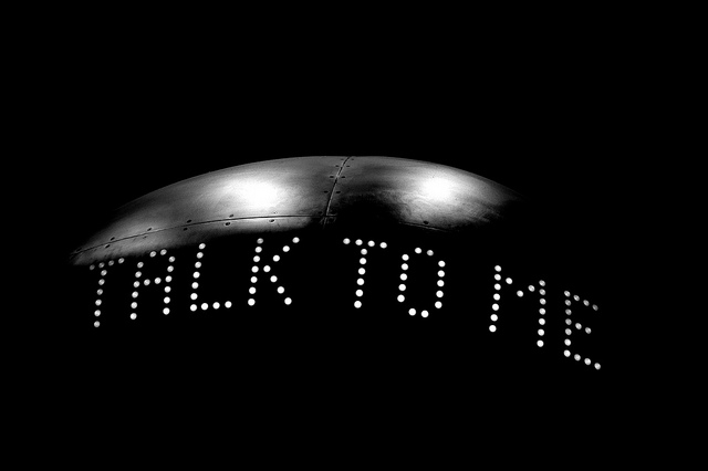The words 'talk to me' displayed on an item photographed at the Science Museum in London